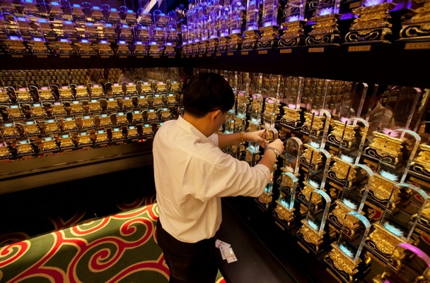 A worker arranges altar tablets at a luxury columbarium in Singapore (Reuters)