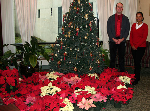 Staff members John and Jennifer at Beechtree Care Center receive Hortus Forum poinsettia donations.