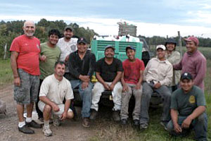 Mario Miranda Sazo (front, left) with farmworkers.