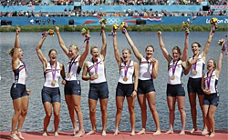 U.S. women's eight team celebrates gold medal and London Olympics.  AP photo.