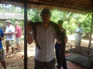 Stephen with a snake at the Mekong delta!