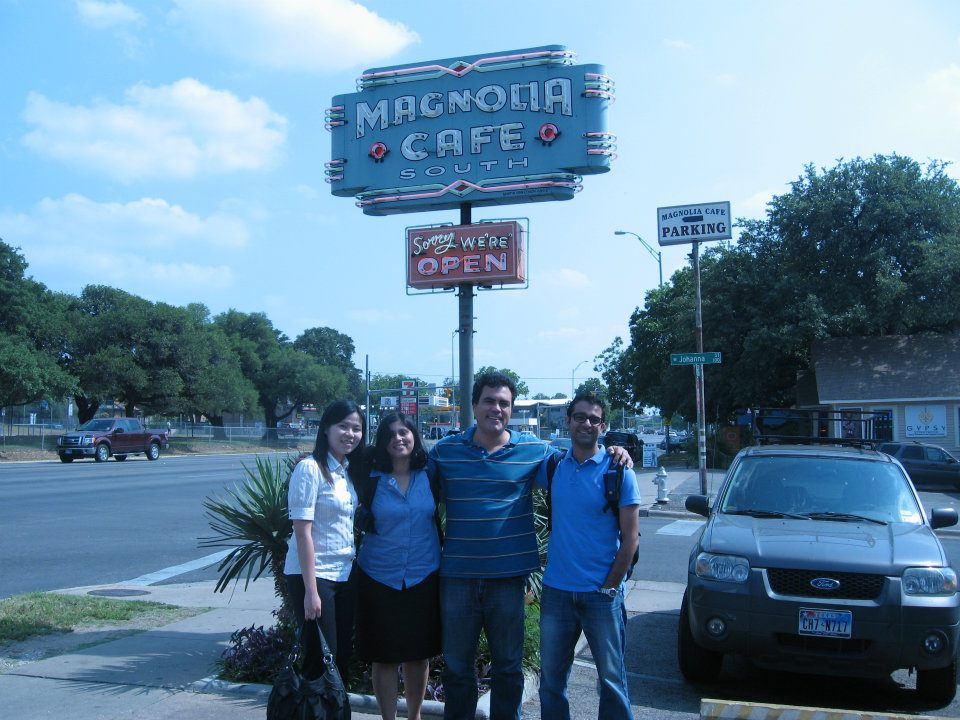 A Texas MBA project team stands in front of the historic Magnolia Cafe