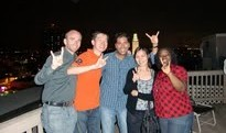 Group of Texas MBAs flashing the Hook'em Horns sign