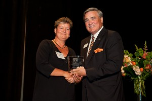 NOV accepts Executive Education Partner Award from Dean Gilligan