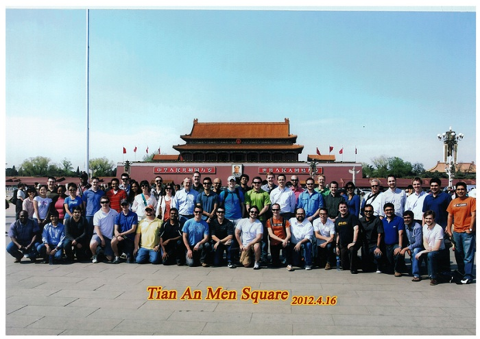 The group of MBA students on the trip pose for a photo at Tian An Men Square
