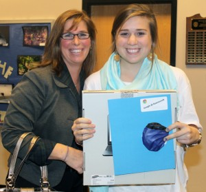 A happy student and mom showing off chromebook