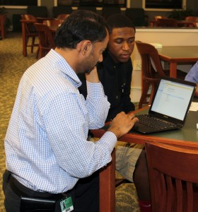 Student Receiving Technical Assistance with Setup