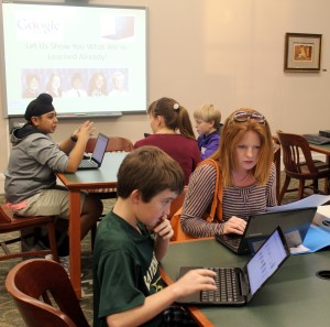 Students showing new Chromebook owners what they've learned