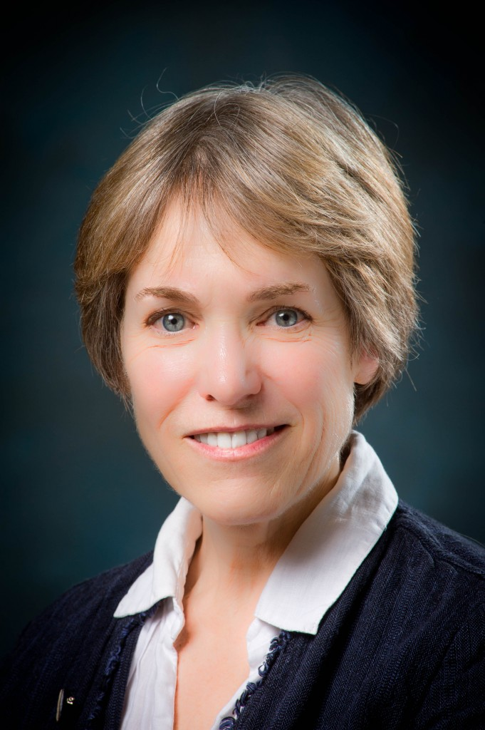Picture of Catheryn Cheal, new Senior Academic Technology Officer, wearing a black jacket and light pink dress shirt. Her hair is light blonde, short and feathered.