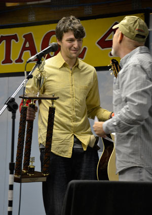 Horrigan accepts 2011 International Finger-style Guitar Championship trophy